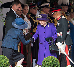 © Licensed to London News Pictures. 23/10/2018. London, UK. Prime Minister THERESA MAY curtseys for QUEEN ELIZABETH II during a ceremony on Horse Guards Parade in London for the arrival of King Willem-Alexander and Queen Maxima of the Netherlands as part of a state visit to the UK. Photo credit: Ben Cawthra/LNP