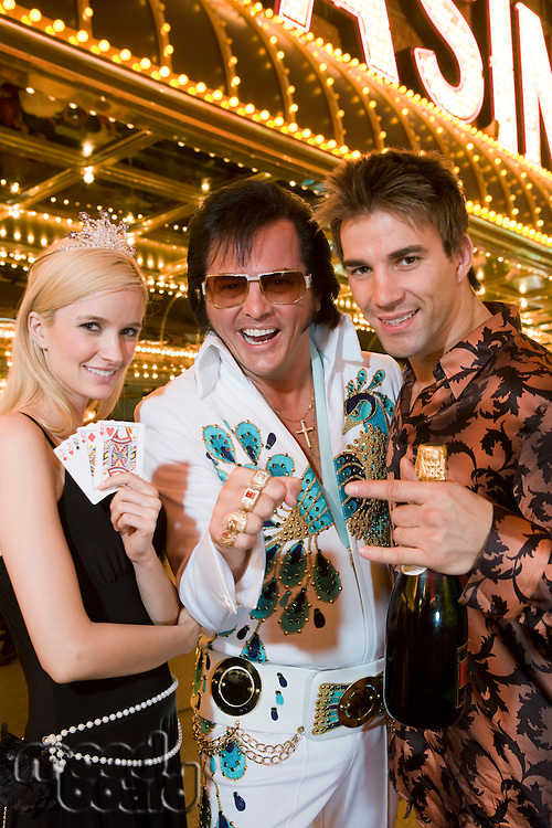 Portrait of couple and Elvis impersonator