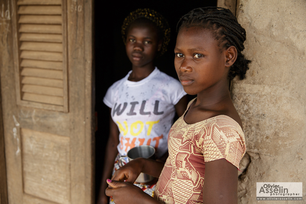 Teenage girls in the doorway of their home in Katiola, Cote d'Ivoire on Friday July 12, 2013.