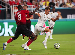 July 31, 2018 - Miami Gardens, Florida, USA - Real Madrid C.F. midfielder Marcos Llorente (18) competes for the ball with Manchester United F.C. defender Eric Bailly (3) during an International Champions Cup match between Real Madrid C.F. and Manchester United F.C. at the Hard Rock Stadium in Miami Gardens, Florida. Manchester United F.C. won the game 2-1. (Credit Image: © Mario Houben via ZUMA Wire)