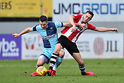 Matthew Bloomfield (10) of Wycombe Wanderers battles for possession with Jordan Tillson (6) of Exeter City during the EFL Sky Bet League 2 match between Exeter City and Wycombe Wanderers at St James' Park, Exeter, England on 10 February 2018. Picture by Graham Hunt.
