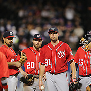 NEW YORK, NEW YORK - July 09: Pitcher Max Scherzer #31 of the Washington Nationals is visited on the mound by Manager Dusty Baker #12 of the Washington Nationals during the Washington Nationals Vs New York Mets regular season MLB game at Citi Field on July 09, 2016 in New York City. (Photo by Tim Clayton/Corbis via Getty Images)