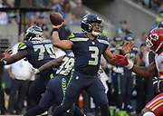 Aug 25, 2017; Seattle, WA, USA; Seattle Seahawks quarterback Russell Wilson (3) throws a pass against the Kansas City Chiefs during a NFL football game at CenturyLink Field.