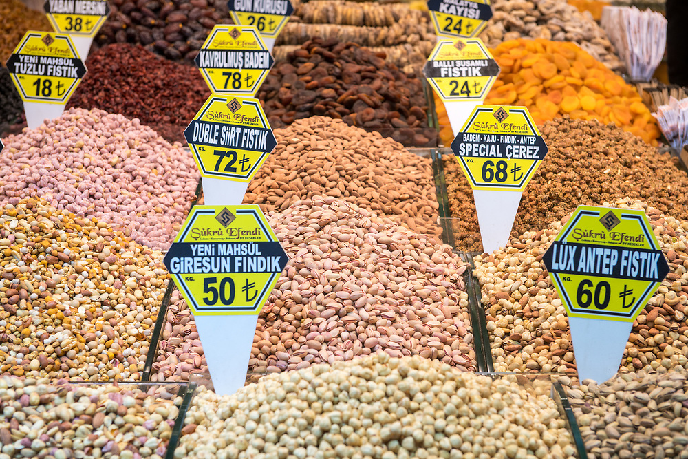 Neat piles of an array of nuts on display for purchase at Istanbul Spice bazaar in Turkey