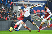 Tottenham Hotspur Forward Harry Kane (10) and Arsenal Defender Nacho Monreal (18) battle for the ball during the Premier League match between Tottenham Hotspur and Arsenal at Wembley Stadium, London, England on 10 February 2018. Picture by Stephen Wright.