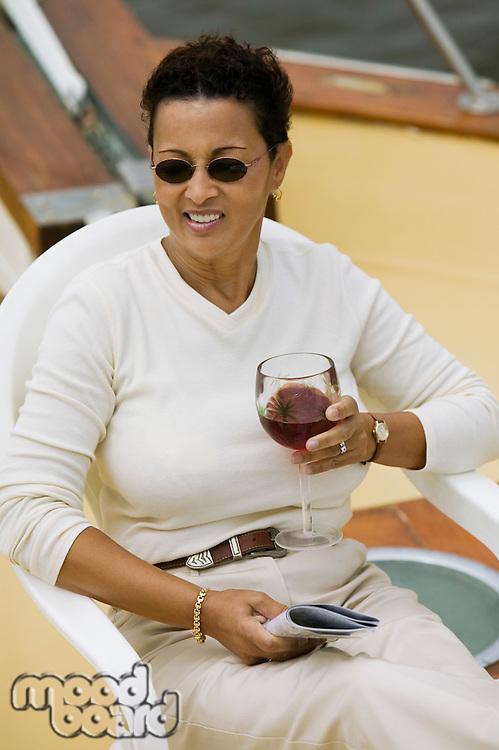 Woman Drinking Wine on Boat