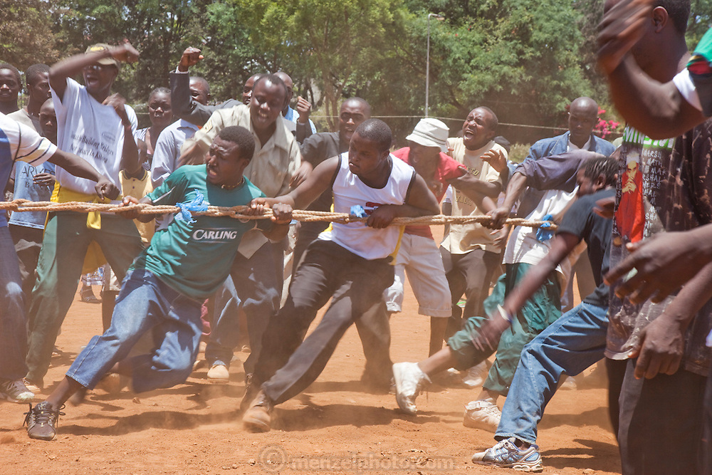 Men engage in a game of tug-of-war in the Kibera slum, Nairobi Kenya. Kibera is Africa's biggest slum with nearly one million inhabitants.
