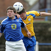 Queen of the South v St Johnstone..30.04.05<br />David McNiven loses out to Ian Maxwell<br /><br />Picture by Graeme Hart.<br />Copyright Perthshire Picture Agency<br />Tel: 01738 623350  Mobile: 07990 594431