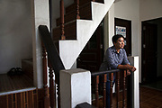 Supaporn Malailoy of the En-Law Foundation in the stairway of her office in the Ramkamhaeng area of Bangkok. She advises communities in Thailand how to use and participate in the legal system so they can defend their own rights, protect nearby natural resources and the environment of their community.
