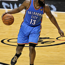 Jun 21, 2012; Miami, FL, USA; Oklahoma City Thunder guard James Harden (13) against the Miami Heat during the third quarter in game five in the 2012 NBA Finals at the American Airlines Arena. Mandatory Credit: Derick E. Hingle-US PRESSWIRE
