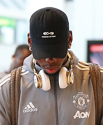 "Manchester United's Paul Pogba arrives at Manchester Airport in a hat that reads ""Scissors vs Fuck"""