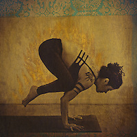 Woman in bakasana with prana flames.