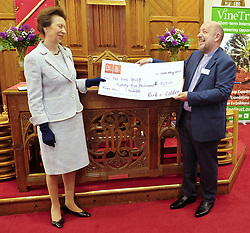 ** Exclusive **<br /> <br /> Princess Royal visits Kirk of Calder, Thursday 25th May 2017<br /> <br /> The Princess Royal visited Kirk of Calder in Mid Calder, Livingston today to accept a cheque on behalf of The Vine Trust.<br /> <br /> The Princess Royal signs the visitor's book before accepting the cheque from the Rev John Povey<br /> <br /> £85,500 has been raised by members and organisations of the kirk to help fund an orphanage in Tanzania.<br /> <br /> There was an increased police presence due to the recent Manchester bombing.<br /> <br /> (c) Alex Todd | Edinburgh Elite media