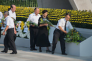 Japan, Hiroshima : HIROSHIMA, JAPAN - AUGUST 06: Citizens of Hiroshima lays a wreath during the 70th anniversary ceremony of the atomic bombing of Hiroshima at the Hiroshima Peace Memorial Park on August 6, 2015 in Hiroshima, Japan. Japan marks the 70th anniversary of the first atomic bomb that was dropped by the United States on Hiroshima on August 6, 1945. The bomb instantly killed an estimated 70,000 people and thousands more in coming years from radiation effects. Three days later the United States dropped a second atomic bomb on Nagasaki which ended World War II.