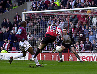 Photo. Glyn Thomas.<br /> Sunderland v West Ham United.<br /> Nationwide Division 1.<br /> Stadium of Light, Sunderland. 13/03/2004.<br /> Sunderland's Sean Thornton (C) shoots but West Ham keeper Stephen Bywater (R) saves before Jeff Whitley pounces on the rebound to score Sunderland's second.
