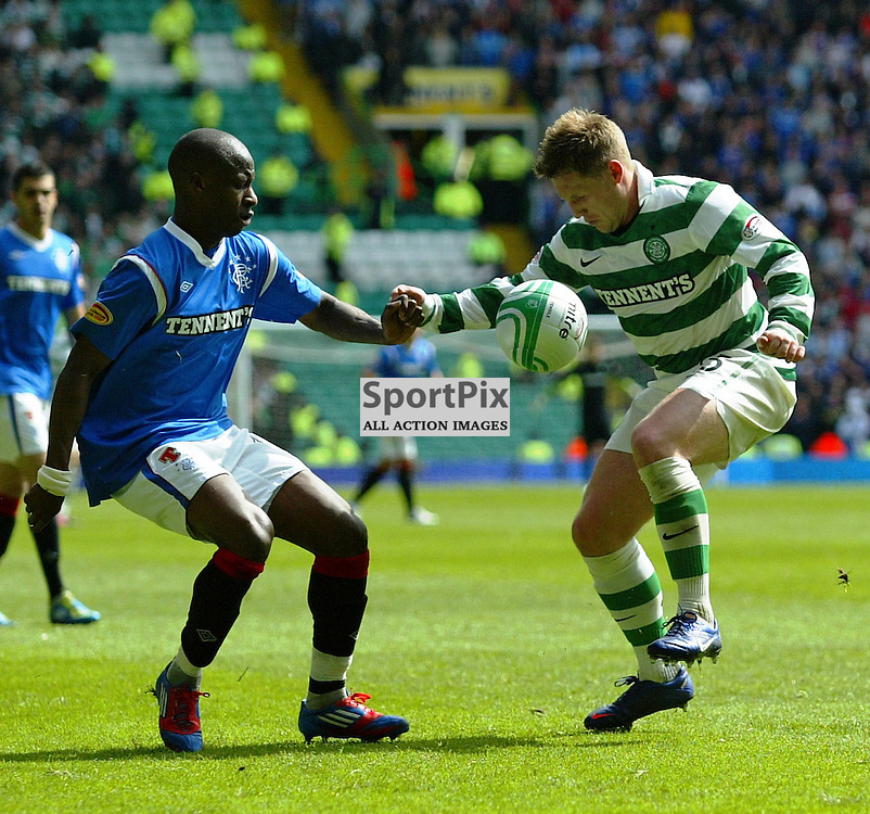 Kris Commons  Celtic tangles with aluko rangers in the scottish premier league clash at celtic park picture kevin mcglynn