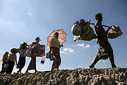 Sunday 19 November 2017 Part of a group of 621 Rohingya refugees who made the crossing from Myanmar, via the Bangladesh border village of Anjuman Para, travel a further ten kilometres towards a processing camp in Cox's Bazar. Photograph by David Dare Parker