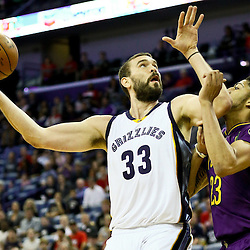 Feb 1, 2016; New Orleans, LA, USA; Memphis Grizzlies center Marc Gasol (33) shoots over New Orleans Pelicans forward Anthony Davis (23) during the first quarter of a game at the Smoothie King Center. Mandatory Credit: Derick E. Hingle-USA TODAY Sports