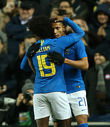 Brazil's Richarlison (right) celebrates scoring his side's first goal of the game with Willian