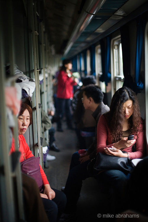 Passengers in the corridor of a train, People's Republic of China