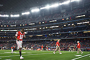 Cardale Jones #12 of the Ohio State Buckeyes warms up before kickoff against the Oregon Ducks during the College Football Playoff National Championship Game at AT&T Stadium on January 12, 2015 in Arlington, Texas.  (Cooper Neill for The New York Times)