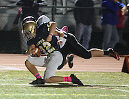 NEWTOWN, PA - OCTOBER 10: Council Rock South's Brendan Patterson #22 is tackled short of the end zone in the second quarter by William Tennent's Kenny Rickards #44 at Council Rock North's Walt Snyder Stadium October 10, 2014 in Newtown, Pennsylvania. (Photo by William Thomas Cain/Cain Images)