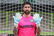 Forest Green Rovers goalkeeper Sam Russell(23) shows off his Wembley gloves during the Forest Green Rovers Press Conference and Training session at the New Lawn, Forest Green, United Kingdom on 12 May 2017. Photo by Shane Healey.