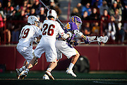 SHOT 5/11/13 6:51:46 PM - Denver's John Zurlo #19 and Carson Cannon #26 try to defend against Albany's Lyle Thompson #4 during their first round NCAA Tournament lacrosse game at the Peter Barton Lacrosse Stadium on the University of Denver campus Saturday May 11, 2013. The University of Denver won the game 19-14 to advance. (Photo by Marc Piscotty / © 2013)