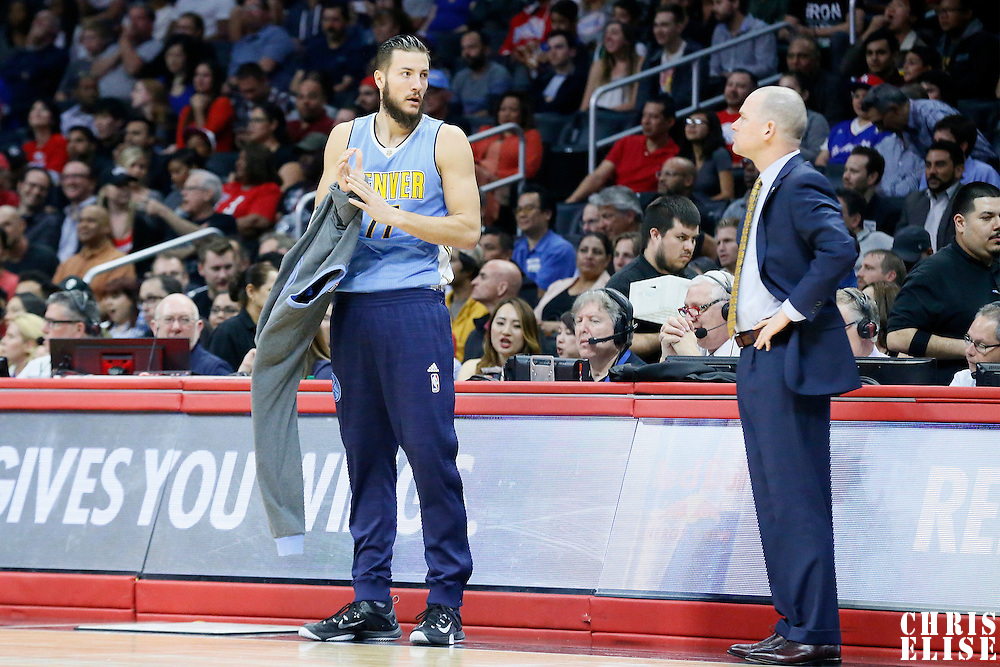 24 February 2016: Denver Nuggets center Joffrey Lauvergne (77) talks to Denver Nuggets head coach Michael Malone during the Denver Nuggets 87-81 victory over the Los Angeles Clippers, at the Staples Center, Los Angeles, California, USA.