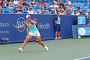 Ashleigh Barty (AUS) hits a forehand to Maria Sharapova (RUS) during the Western and Southern Open tennis tournament at Lindner Family Tennis Center, Wednesday, Aug 14, 2019, in Mason, OH. (Jason Whitman/Image of Sport)