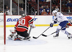 Jan 29, 2010; Newark, NJ, USA; New Jersey Devils goalie Martin Brodeur (30) makes a save on Toronto Maple Leafs right wing Lee Stempniak (12) during the first period at the Prudential Center.