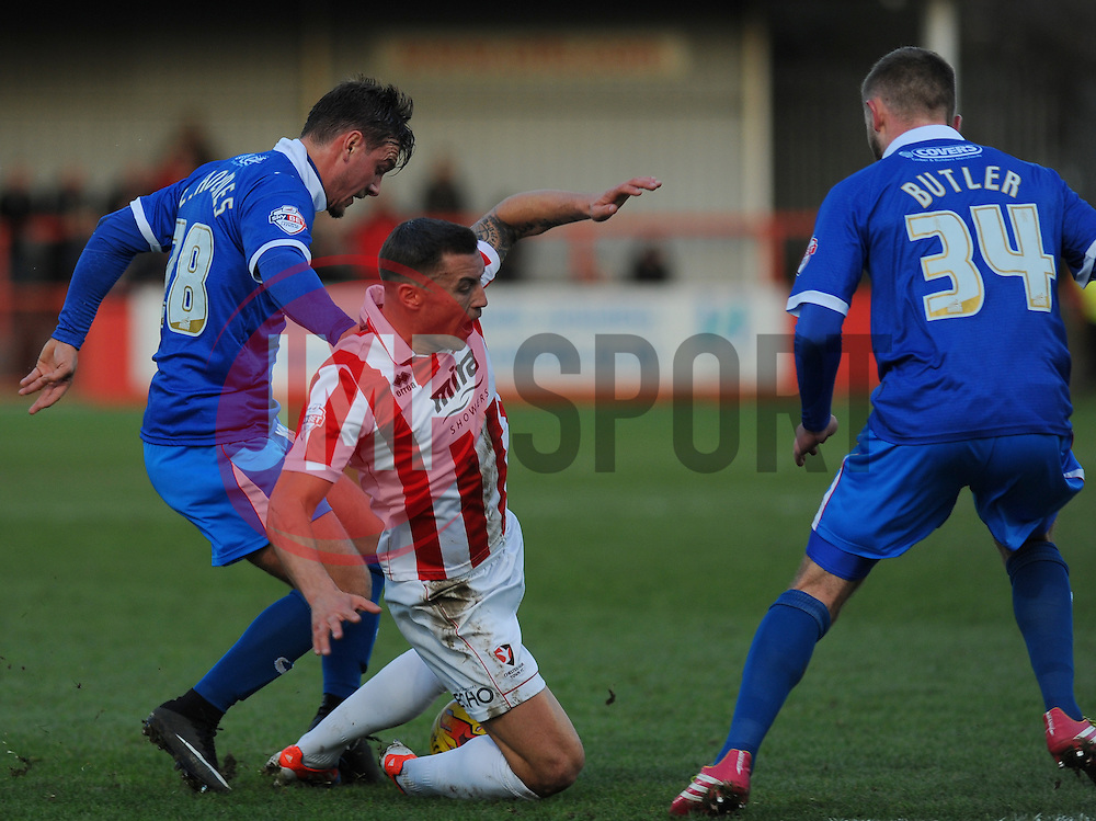 Cheltenham Town's Terry Gornell gets tackled. - Photo mandatory by-line: Nizaam Jones/JMP - Mobile: 07966 386802 20/12/2014 - SPORT - FOOTBALL - Cheltenham - Whaddon Road - Cheltenham Town v Portsmouth - Sky Bet League Two