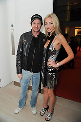 SCOT YOUNG and NOELLE RENO at a reception to launch the Saatchi Opus held at the Saatchi Gallery, King's Road, London on 26th November 2009.