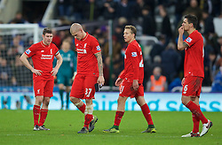 NEWCASTLE-UPON-TYNE, ENGLAND - Sunday, December 6, 2015: Liverpool's dejected players James Milner, Martin Skrtel, Lucas Leiva and Dejan Lovren after the 2-0 defeat to Newcastle United during the Premier League match at St. James' Park. (Pic by David Rawcliffe/Propaganda)