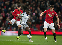 Frank Nouble of Colchester United (C) in action against Harry Maguire (R) and Andreas Pereira of Manchester United - Mandatory by-line: Jack Phillips/JMP - 18/12/2019 - FOOTBALL - Old Trafford - Manchester, England - Manchester United v Colchester United - English League Cup Quarter Final