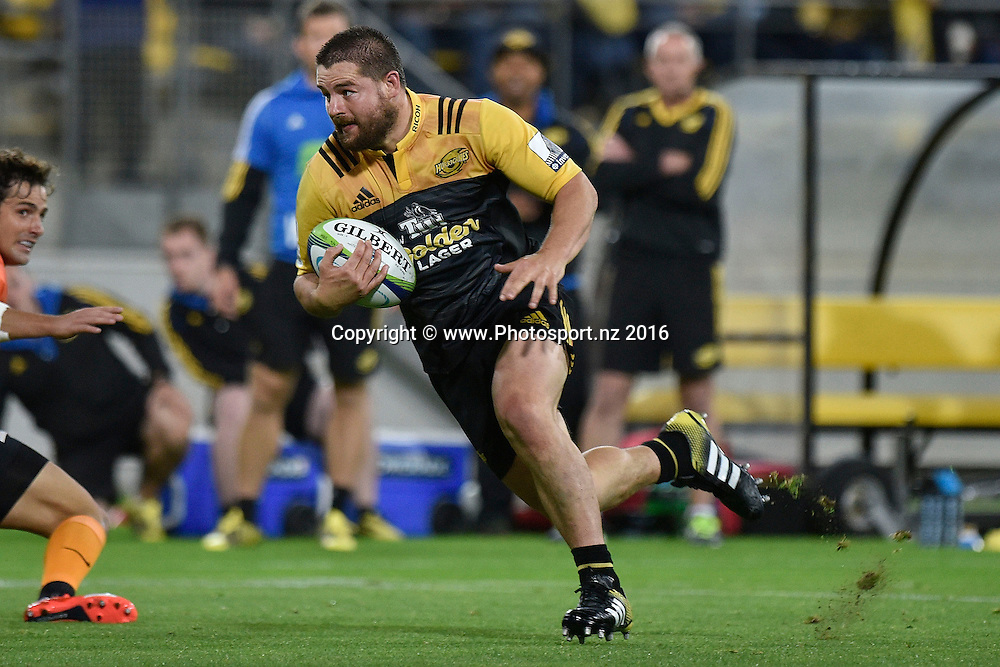 Dane Coles captain of the Hurricanes runs with the ball during the Hurricanes vs Jaguares Super Rugby match at the Westpac Stadium in Wellington on Saturday the 09 of April 2016. Copyright Photo by Marty Melville / www.Photosport.nz