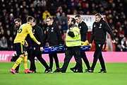 Shkodran Mu him stafi (20) of Arsenal is carried off on a stretcher after being injured with Rob Holding (16) of Arsenal replacingduring the The FA Cup match between Bournemouth and Arsenal at the Vitality Stadium, Bournemouth, England on 27 January 2020.