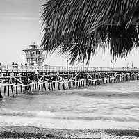 San Clemente pier and tiki umbrella black and white panorama photo. San Clemente is a popular coastal town in Orange County Southern California in the United States of America. Copyright ⓒ 2017 Paul Velgos with all rights reserved.