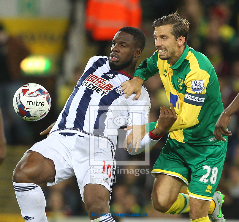 Victor Anichebe of West Bromwich Albion and Gary O&rsquo;Neil of Norwich during the Capital One Cup match at Carrow Road, Norwich<br /> Picture by Paul Chesterton/Focus Images Ltd +44 7904 640267<br /> 23/09/2015