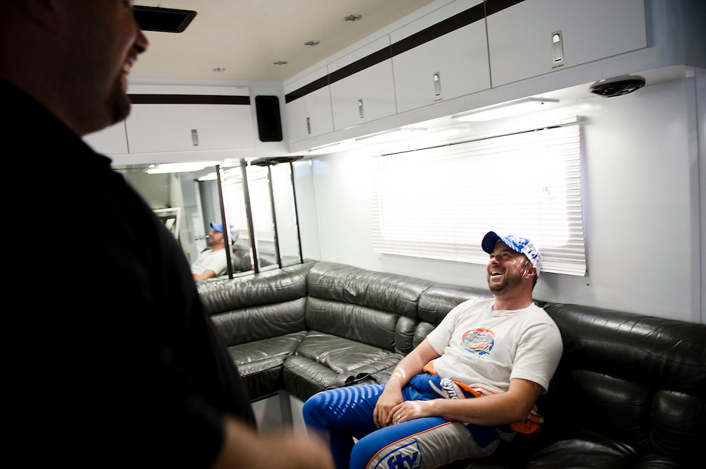 NEWTON, IOWA. -AUG. 1, 2014: NASCAR driver Eric McClure and Kyle Powers, his bus driver, relax in between practices for the NASCAR Nationwide Series auto race at Iowa Speedway Friday, Aug. 1, 2014. Lauren Justice for The New York Times