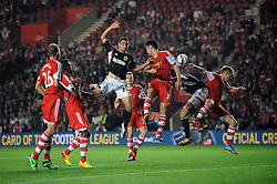 Bristol City's Stephen McLaughlin heads the ball towards goal - Photo mandatory by-line: Dougie Allward/JMP - Tel: Mobile: 07966 386802 24/09/2013 - SPORT - FOOTBALL - St Mary's Stadium - Southampton - Southampton V Bristol City - Capital One Cup