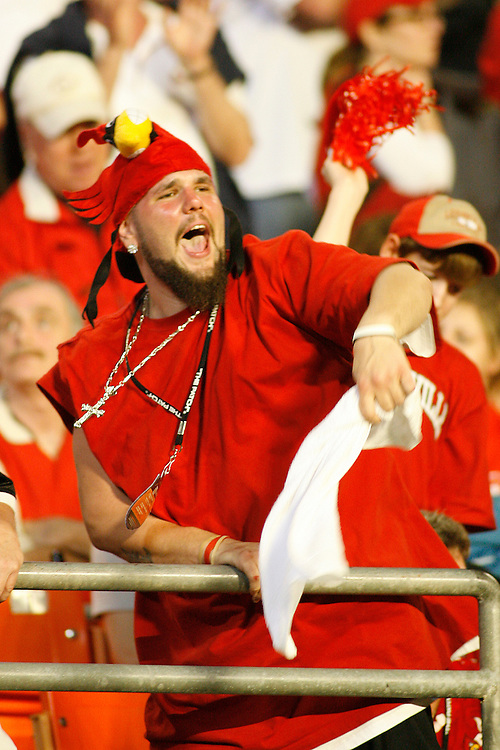 A University of Louisville fan cheers during the Louisville Cardinals 24-13 victory over the Wake Forest Demon Deacons at the 2007 Orange Bowl Game on January 2, 2007 at the Dolphin Stadium in Miami, Florida.