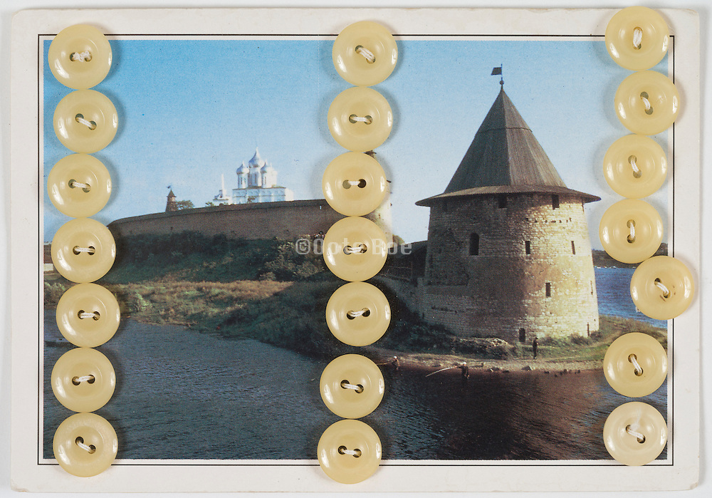 old Russian postcard with buttons sewn on it