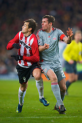 EINDHOVEN, THE NETHERLANDS - Tuesday, December 9, 2008: Liverpool's Jamie Carragher and PSV Eindhoven's Danko Lazovic during the final UEFA Champions League Group D match at the Philips Stadium. (Photo by David Rawcliffe/Propaganda)