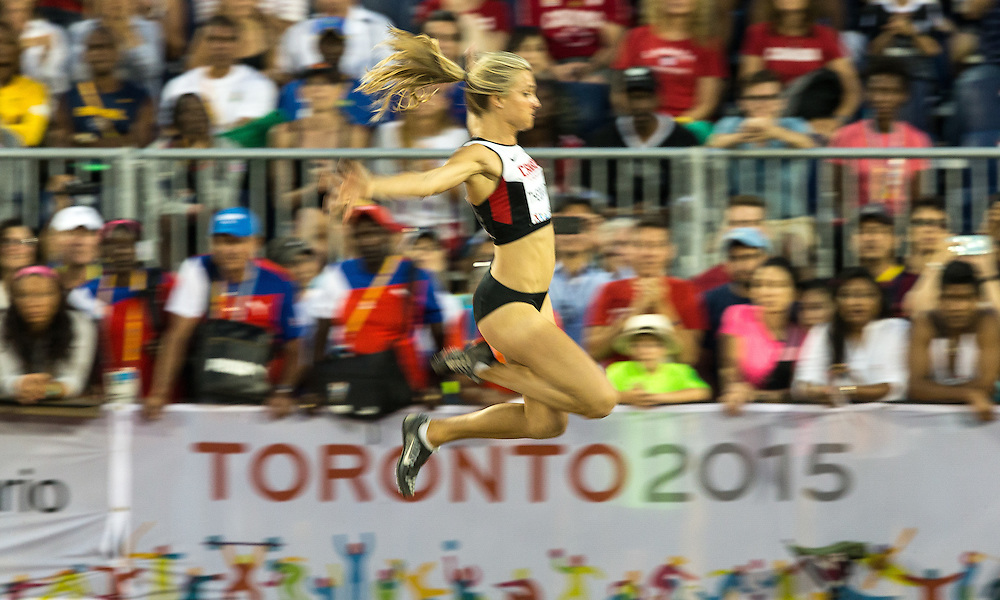 Brianne Theisen-Eaton of Canada competes in the women's long jump at the 2015 Pan American Games at CIBC Athletics Stadium in Toronto, Canada, July 24,  2015.  AFP PHOTO/GEOFF ROBINS