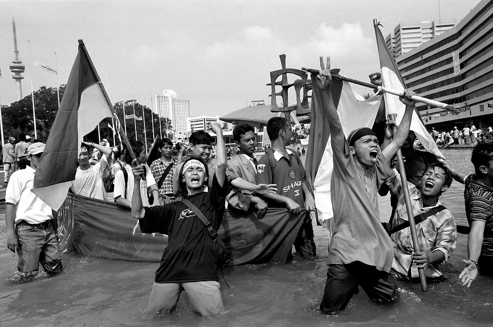 Students celebrate in the fountain within the People's Consultative Assembly as Suharto's 32 year rule comes to an end, May 21 1998.