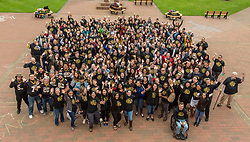 First in the family group photo made up of staff, faculty, and students at PLU, Friday, April 27, 2018. (Photo: John Froschauer/PLU)