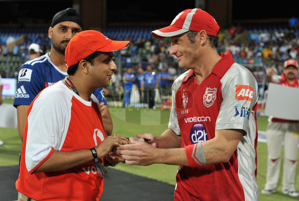 David Hussey of Kings XI Punjab signs the ball for the Vodafone man of the match during match 28 of the Indian Premier League ( IPL) 2012  between The Mumbai Indians and the Kings X1 Punjab held at the Wankhede Stadium in Mumbai on the 22nd April 2012..Photo by Pal Pillai/IPL/SPORTZPICS.