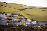 BORTH, WALES, UK 16TH MARCH 2020 - Static caravan seaside holiday resort lining a hill side along the Ceredigion coastal footpath, Borth, Wales, UK.