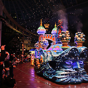 The night time parade with colorful illuminated floats and characters at Lotte World. Lotte World is the world's largest indoor theme park which includes shopping malls, a luxury hotel, and an Ice rink. Opened on July 12, 1989, Lotte World receives over 8 million visitors each year. Seoul, South Korea. 21st March 2012. Photo Tim Clayton